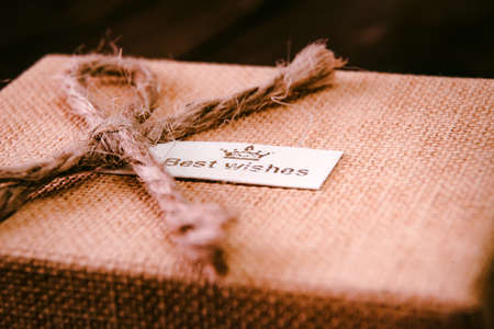 Close up beautiful giftbox wrapped in canvas