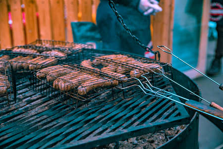 BBQ sausages on grill close Stock Photo