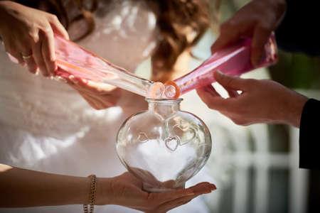 Mixing sand at wedding ceremony Stock Photo