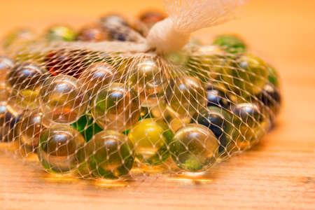 Close up beautiful decorative glass balls in white net
