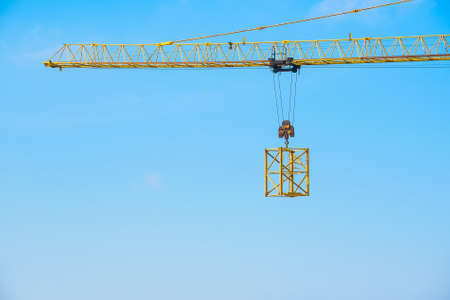 Yellow crane at construction site