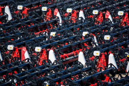 New combine headers stored on plant Stock Photo