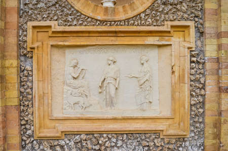 ROME, ITALY - SEPTEMBER 26, 2017: Ancient sculpture paintings on wall in Villa Doria-Pamphili in Rome, Italy