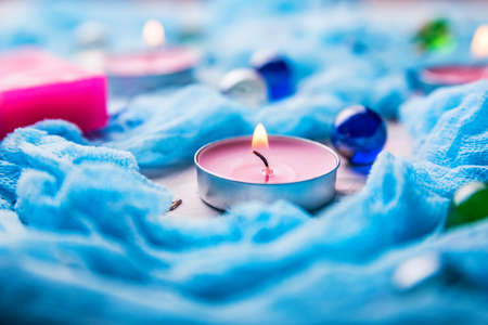 Romantic background with candles, soap and shawl