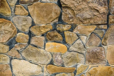 Close-up decorative beige stonewall texture 免版税图像