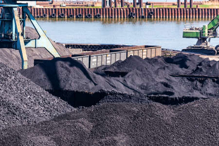 View of piles of coal stored in sea port in Taganrog, Russia