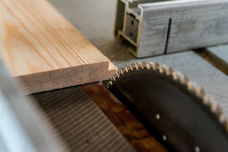 Circular saw cuts wood close up image
