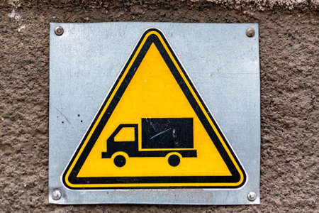 Close up yellow sign with image of truck