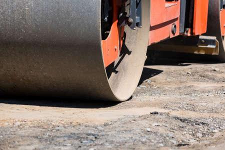 Road roller compactor at asphalt road repairing