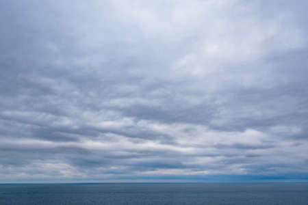 View of calm sea and grey cloudy sky