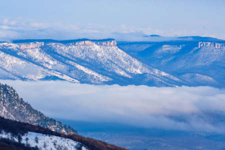 Beautiful distant winter mountains landscape with clouds