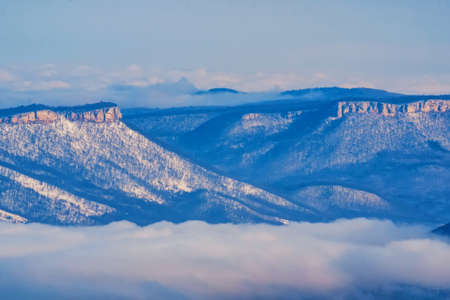 Beautiful panoramic winter mountains landscape with mist