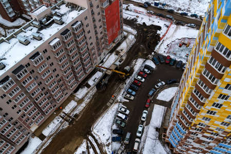 Top view snowy construction site with new appartment building