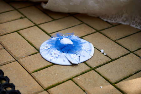 Breaking plates on wedding popular tradition. Plate on floor Stock fotó