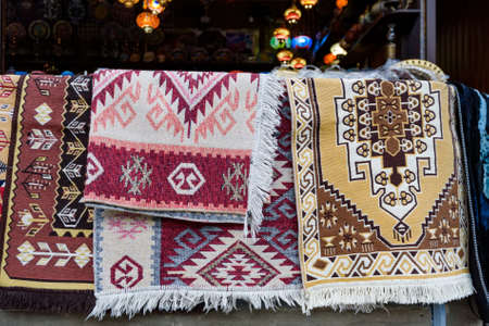 Hand made carpets hanging in street market Stock fotó