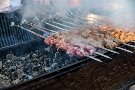 Close up pieces of meat, shashlik or barbeque on skewers