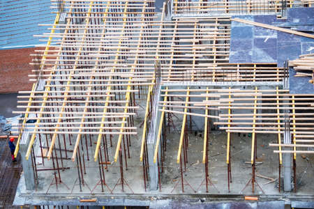Wooden frames and metal reinforcement at new building construction site Stock fotó