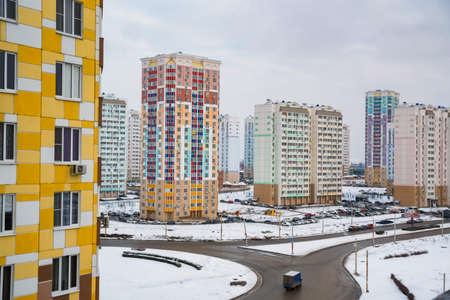 Distant view of a construction site with new buildings in winter
