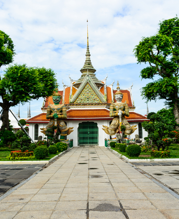 archiitecture: TWO GIANTS PROTECTED DEMON ENTRANCE TO THE CHURCH AT WAT ARUN     TEMPLE OF DAWN           BANGKOK,THAILAND