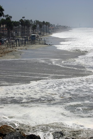 Oceanside strand takes beating from the surf