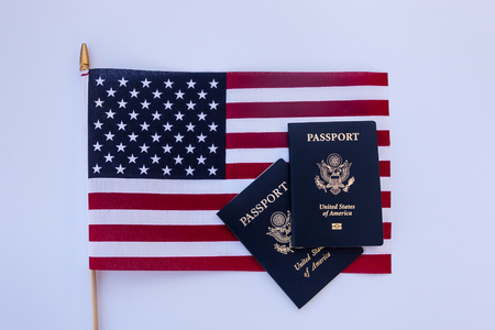 USA flag with two passports on a solid background 写真素材