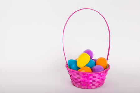 Easter egg basket with colorful plastic Easter eggs