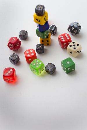 Vertical rolled and stacked gaming dice multiple colors