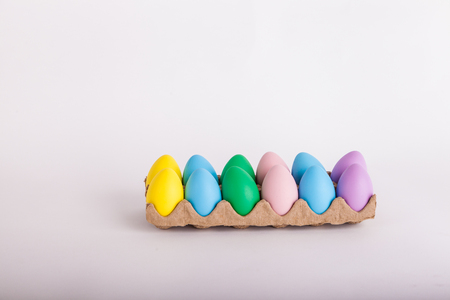 Easter eggs in a carton painted pastel colors