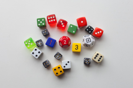 Random gaming dice roll on a solid background