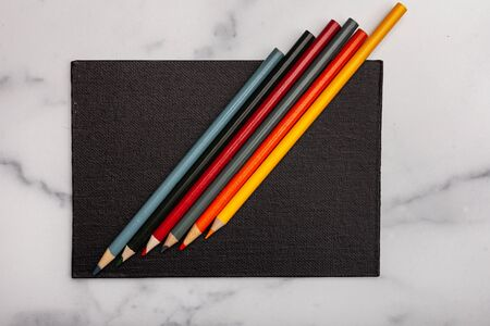 Black canvas with coloring pencils background texture