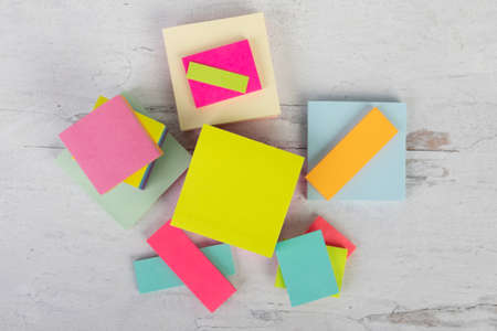 Flat lay background of colorful assorted sizes and colors sticky posted noted blank empty ready to add content or words