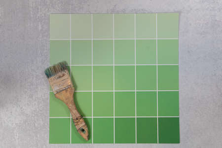 Green color palette swatch card flat lay background with art paint brush