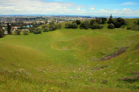 Mangere Mountain (also Mangere Domain, for the park) is one of the largest volcanic cones in the Auckland Volcanic Field, with a peak 106 metres above sea level, and was the site of a major p?. Many of the p?s earthworks are still very evident. It offers Stock Photo