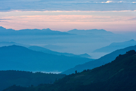 View of mountains in early morning rays of light, in Himalayas, Langtang National Park, Nepal Stock Photo