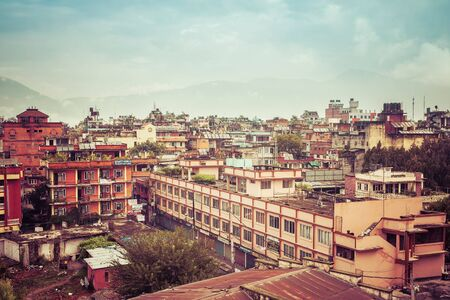 Pokhara, Nepal - September 28, 2011:  Urban landscape - rooftops of poor houses in Pokhara town, Nepal Stock Photo