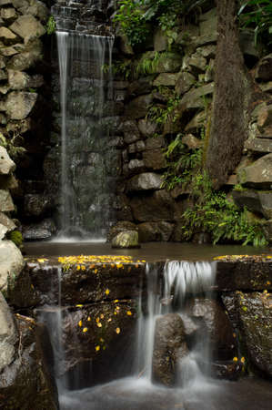 cascade: Waterfall at Alfred Nicholas Memorial Gardens, Victoria, Australia Stock Photo