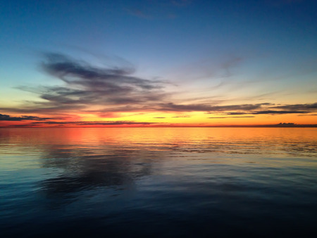 Smooth water surface in orange sunset  colors Stock Photo