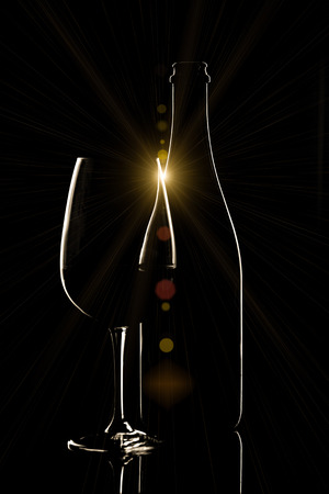 Red wine bottle and wine glass on black background Stock Photo