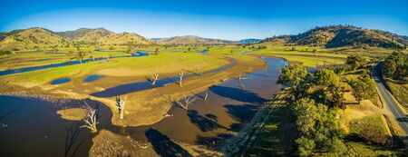 Aerial panorama of beautiful Australian countryside pastures and meadows on bright sunny day