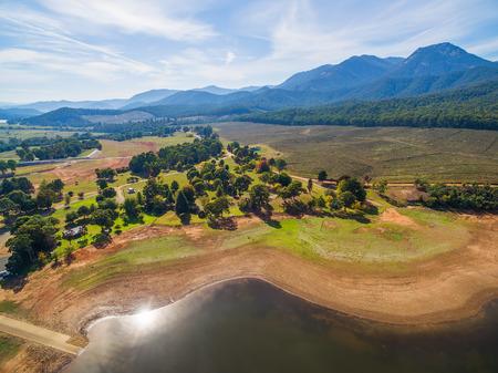Aerial rural landscape Victoria Australia.  Mount Buffalo and Lake Buffalo at high noon