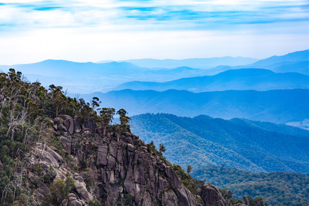 Mount Buffalo National Park - Rocks and layers of blue hills. Victoria, Australia