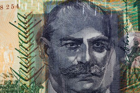 one hundred dollars: Light shining through 100 dollar bill showing prints of portrait on both sides of the banknote. Extreme closeup