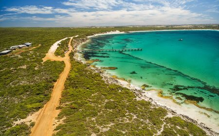 Aerial view of Vivonne Bay pier and vivid turquoise ocean water, Kangaroo Island, South Australia Stock Photo