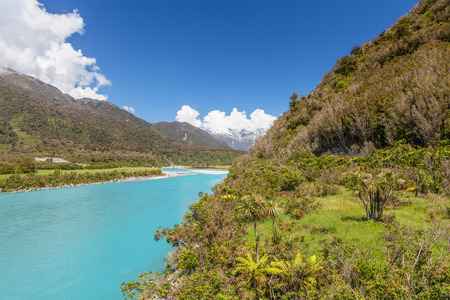 View of Whataroa River and Southern Alps in the distance. West Coast, South Island, New Zealand. Stock Photo
