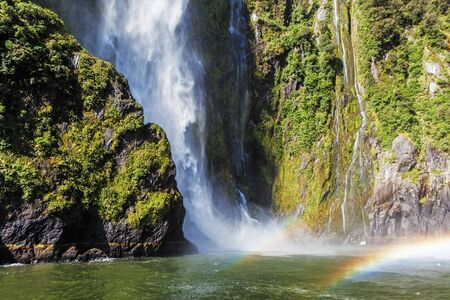 Incredible Stirling Falls with double rainbow, Milford Sound, Fiordland, South Island, New Zealand