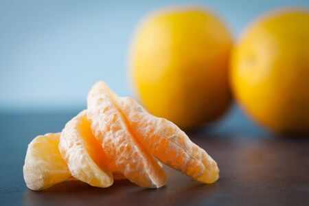Extreme closeup of orange slices on blurred background. Shallow depth of field. Stock Photo