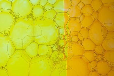 Soap bubbles macro - geometric design in yellow and orange