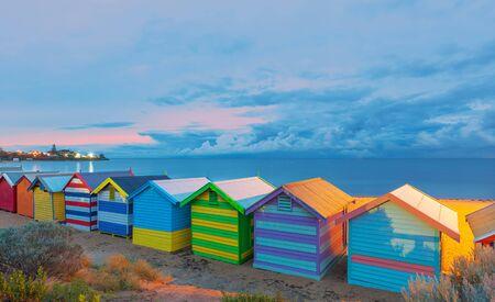 st kilda: Happy Brighton beach huts, at pink sunrise, Melbourne, Victoria, Australia.