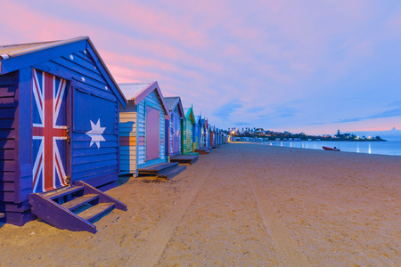 Beautiful Brighton bathing houses with rescue boat at sunrise, Melbourne, Australia