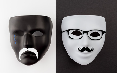 Black sad and white happy masks with mustache and glasses Stock Photo